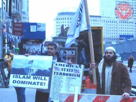 Protest in New York City, February 1, 2006 -  Note the black flag of Islam, the battle-flag of jihad, flying over the White House on the placard at left.